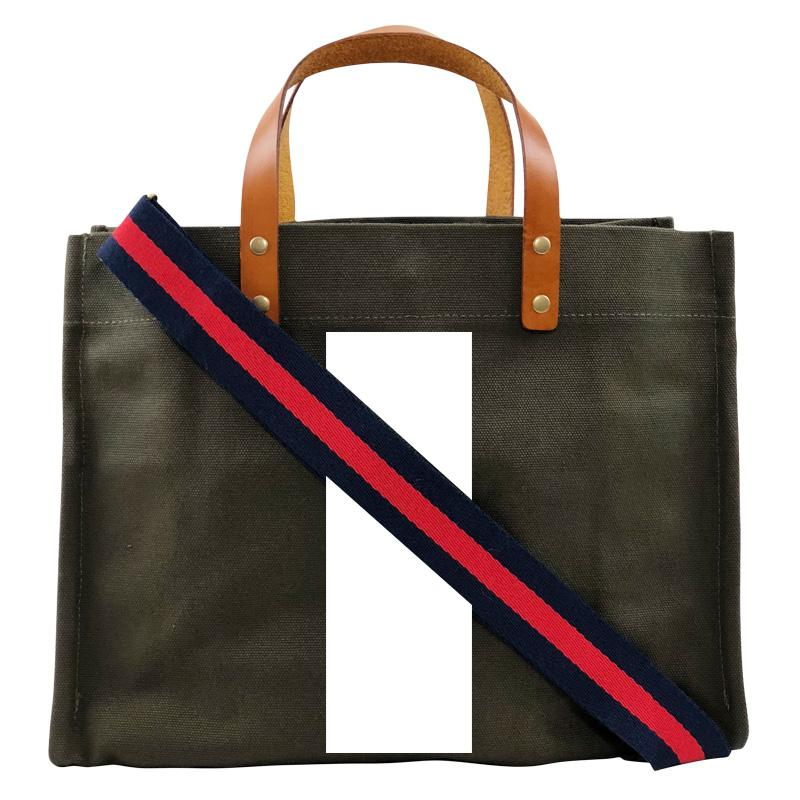 i am bold white stripe-mimi bag olive with navy and red webbed strap