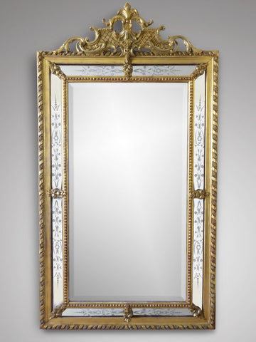 The large 19th century giltwood wall mirror is a brilliant statement piece.