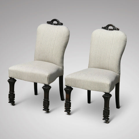 This fabulous pair of side chairs dating c. 1890 feature decorative carved crestings.