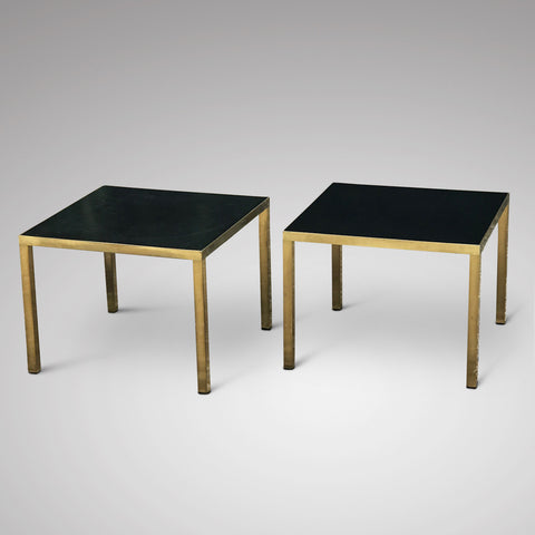 A stylish pair of retro brass side tables with rich black Formica tops