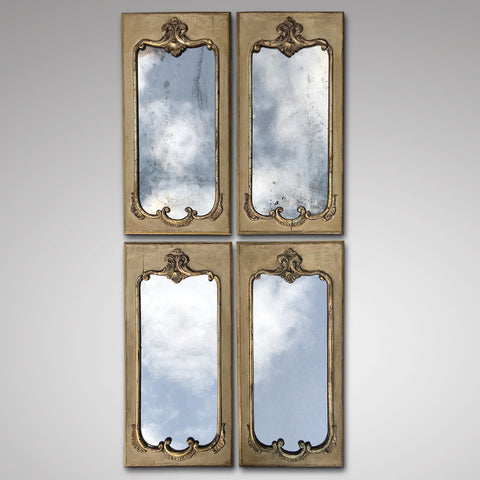A stunning set of four 19th Century Italian mirrors inject a sense of European style for a striking focal point.