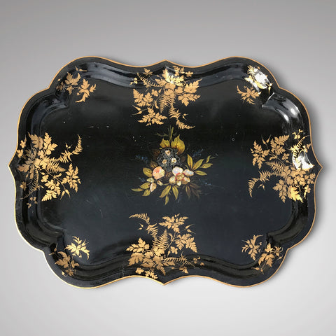 A 19th century papier mache tray dating c. 1880 with black lacquered background