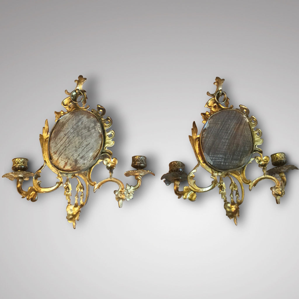 A Pair of 19th Century Gilt Metal Girandoles - View of back of mirrors