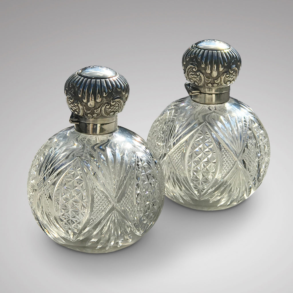 A Pair of Antique Silver Topped Scent Bottles