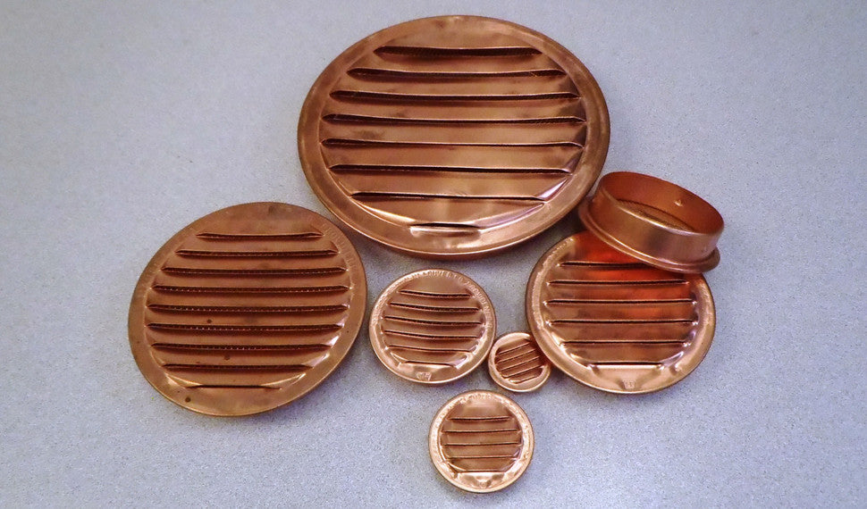 A collection of round copper vents.