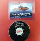NHL Detroit Red Wings Henrik Zetterberg Autographed Puck (COA) - Hockey Cards Plus LLC