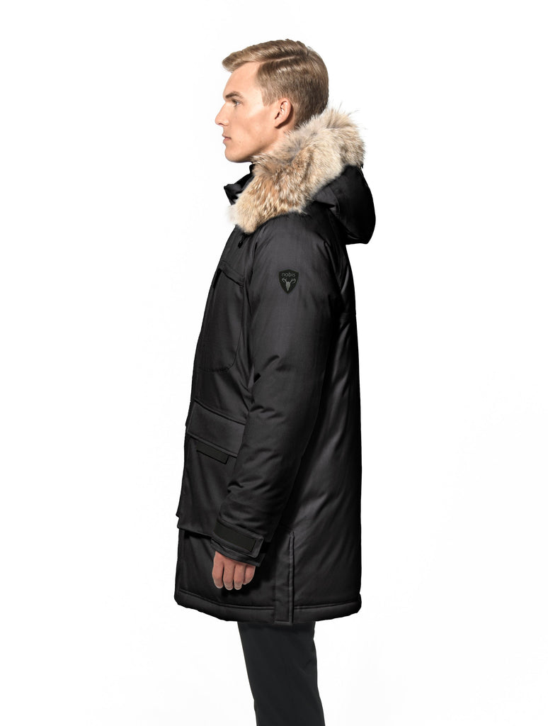 Men's thigh length down-filled parka with removable hood and removable coyote fur trim in Black