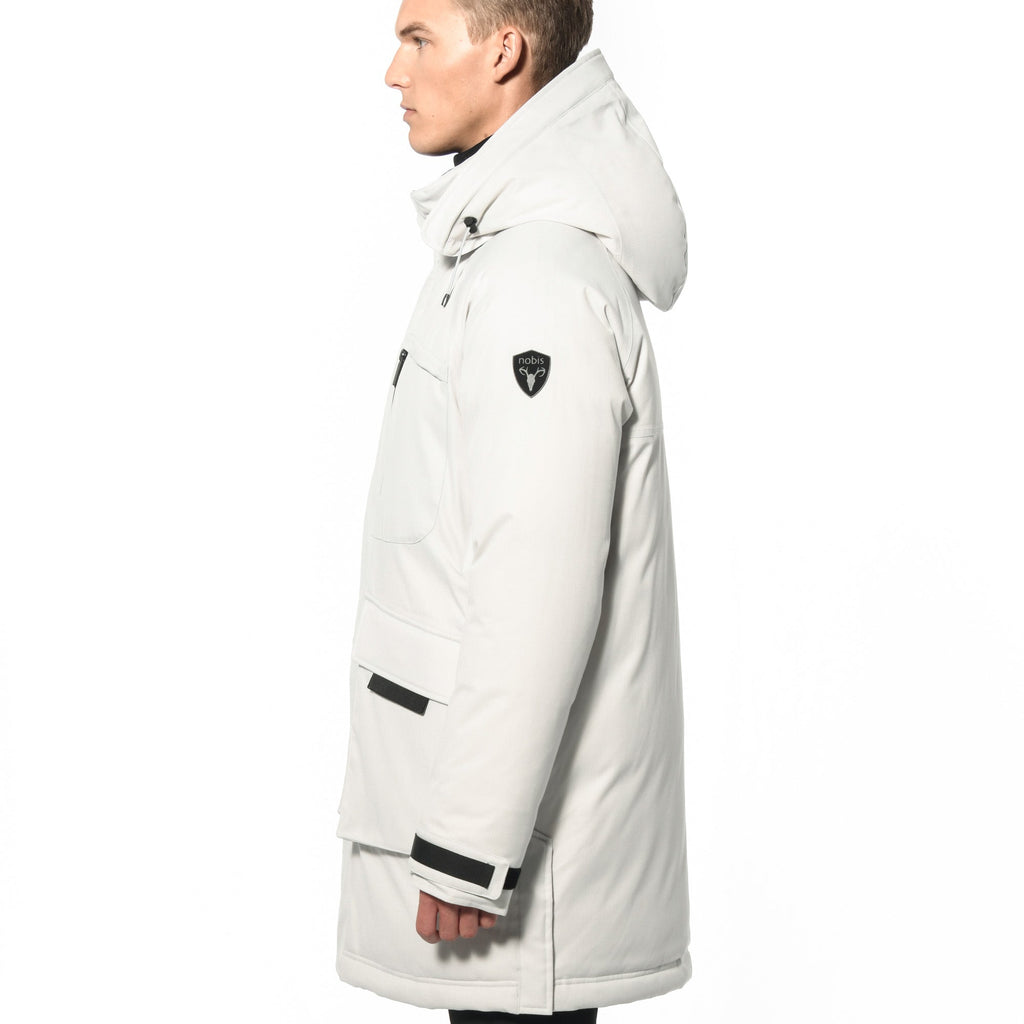 Men's thigh length down-filled parka with removable hood and removable coyote fur trim in Chalk