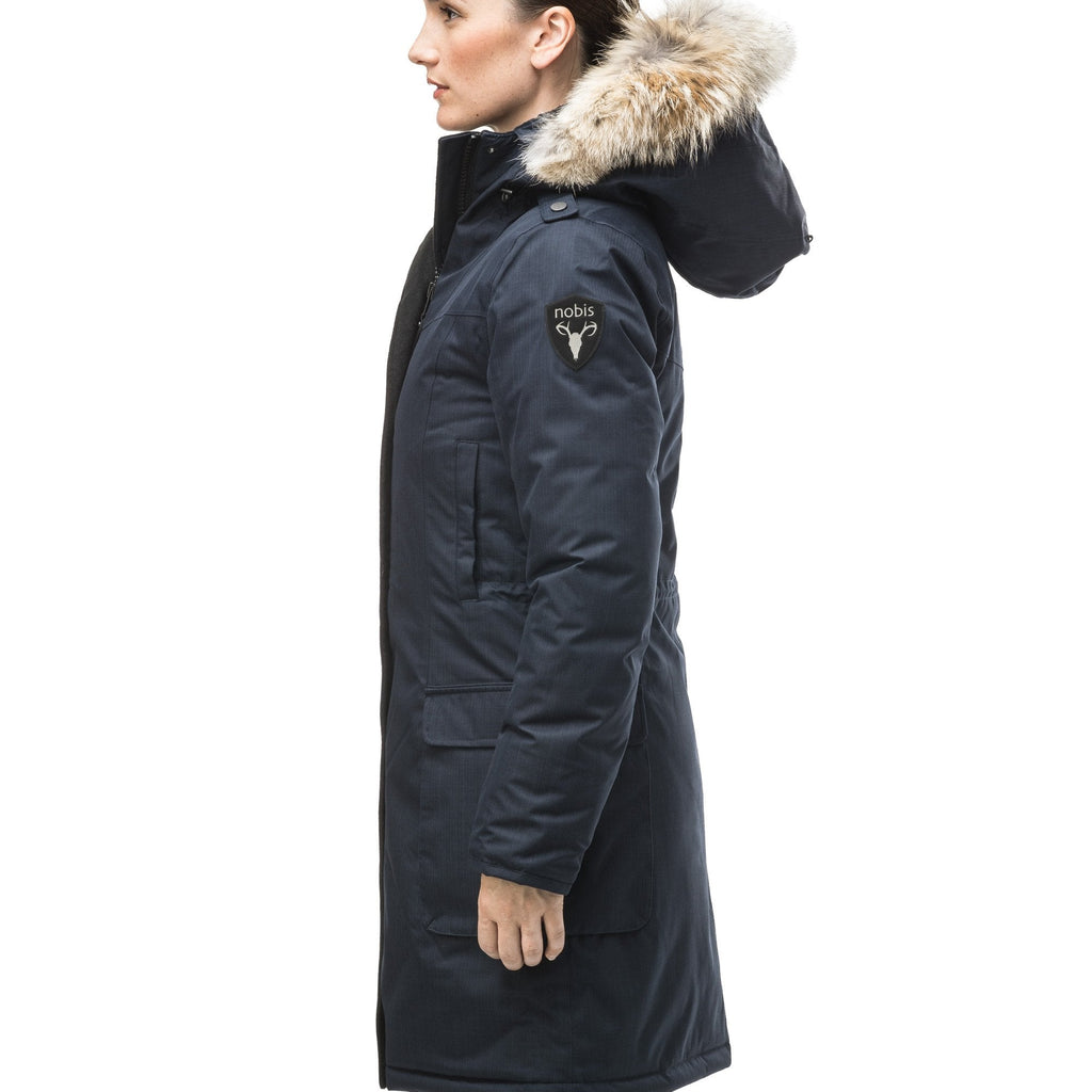 CH Navy down filled parka with a black nobis shield patch on the left bicep