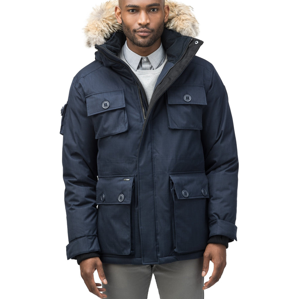 Men's down filled parka with four patch pockets and an adjustable waist with removable hood and removable fur trim in CH Navy