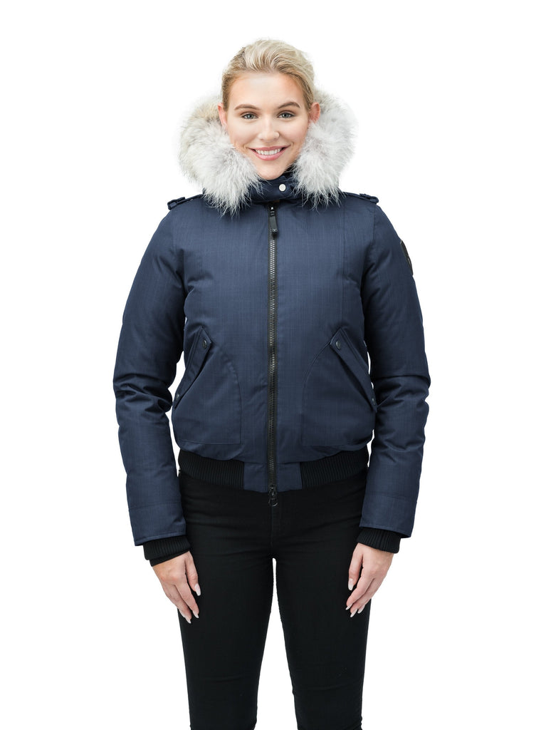 Women's bomber style down filled jacket with a removable hood and fur trim in CH Navy