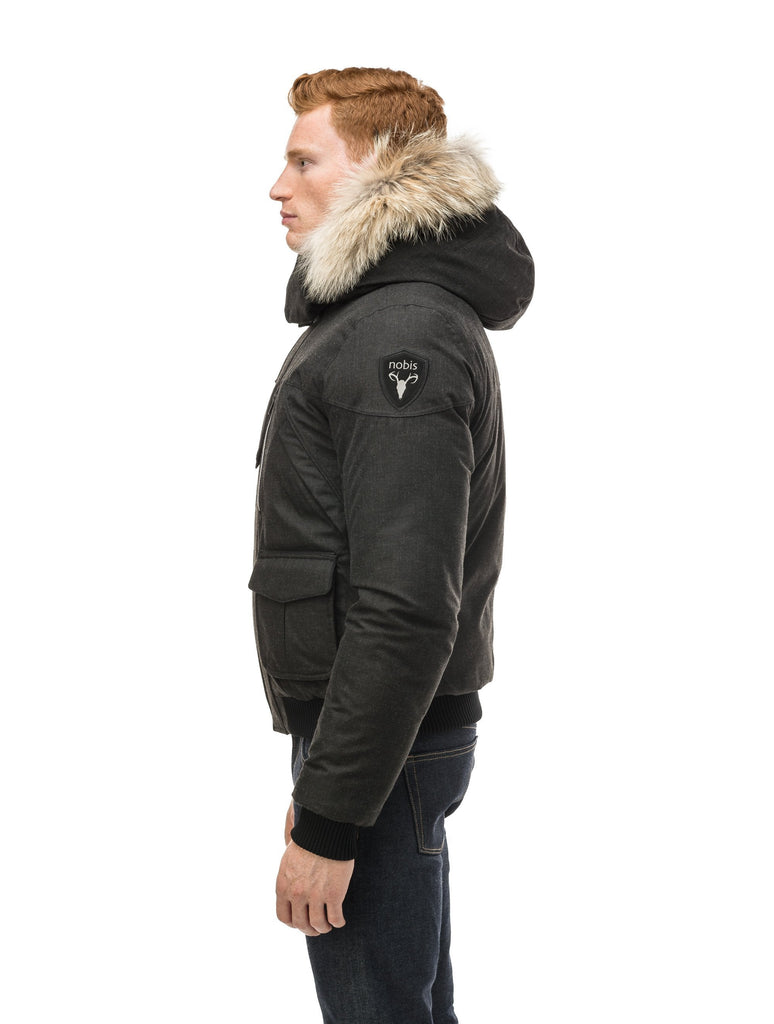 Men's classic down bomber with two patch pockets and a right shoulder storm flap in H. Black