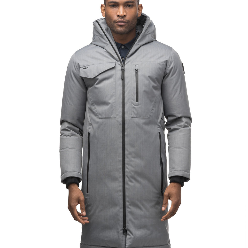 Long men's calf length parka with down fill and exposed zipper that features spacious pockets and zippered vents in Concrete