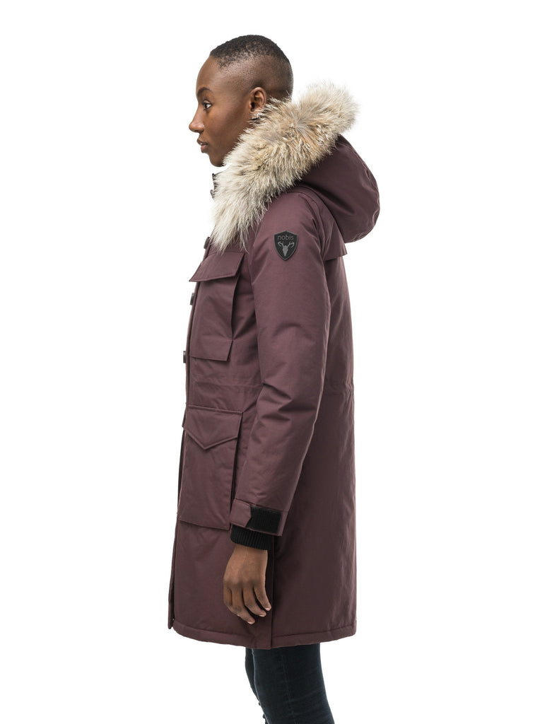 Women's knee length down filled parka with two chest patch pockets and two waist patch pockets in Burgundy