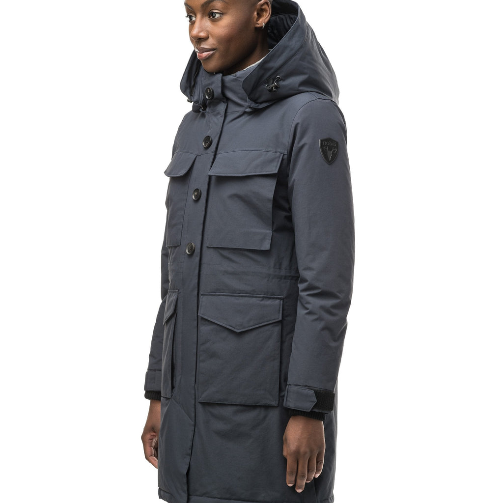 Women's knee length down filled parka with two chest patch pockets and two waist patch pockets in Navy