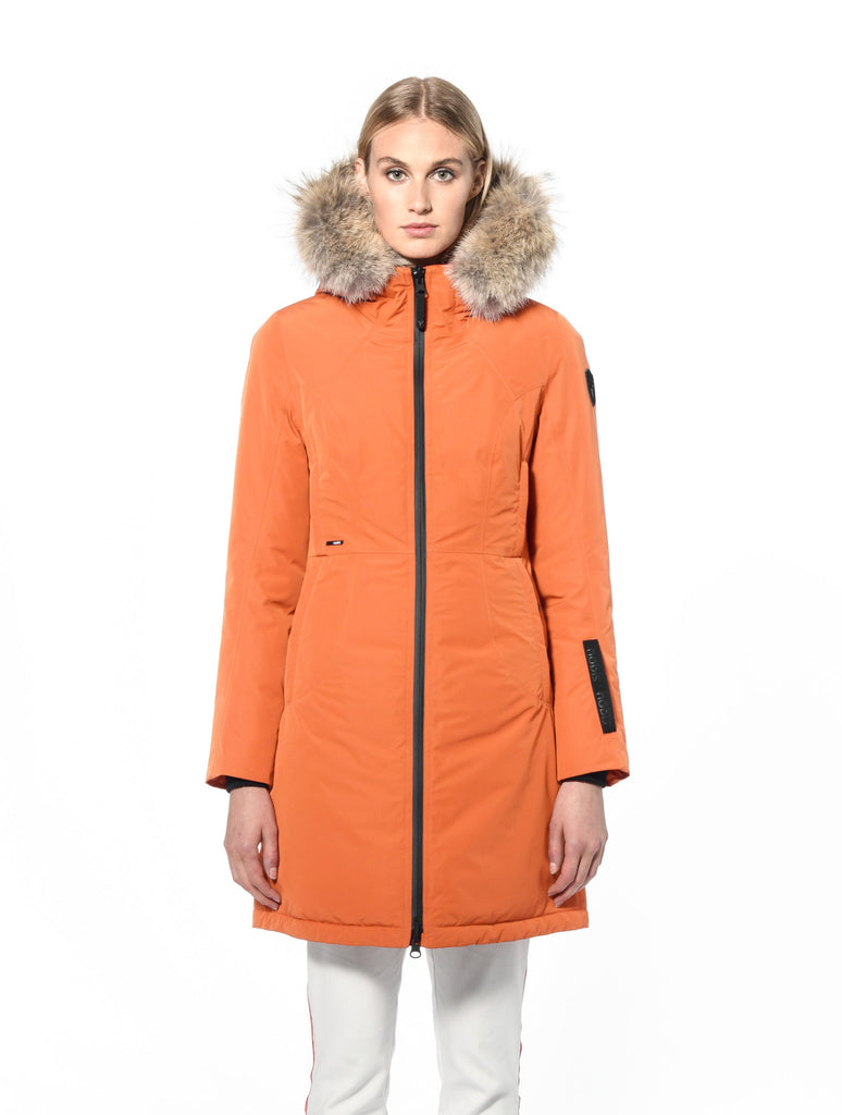 Ladies thigh length down-filled parka with non-removable hood and removable coyote fur trim in Atomic