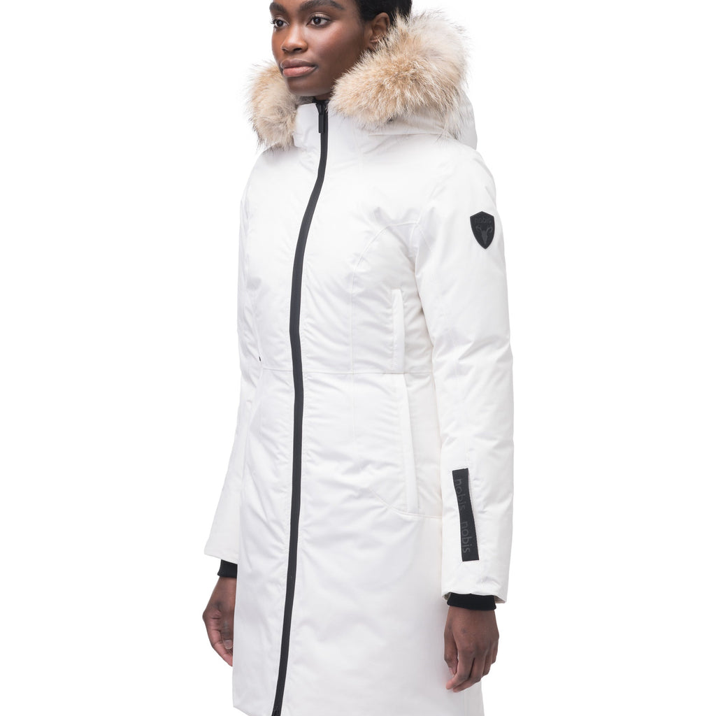 Ladies thigh length down-filled parka with non-removable hood and removable coyote fur trim in Chalk