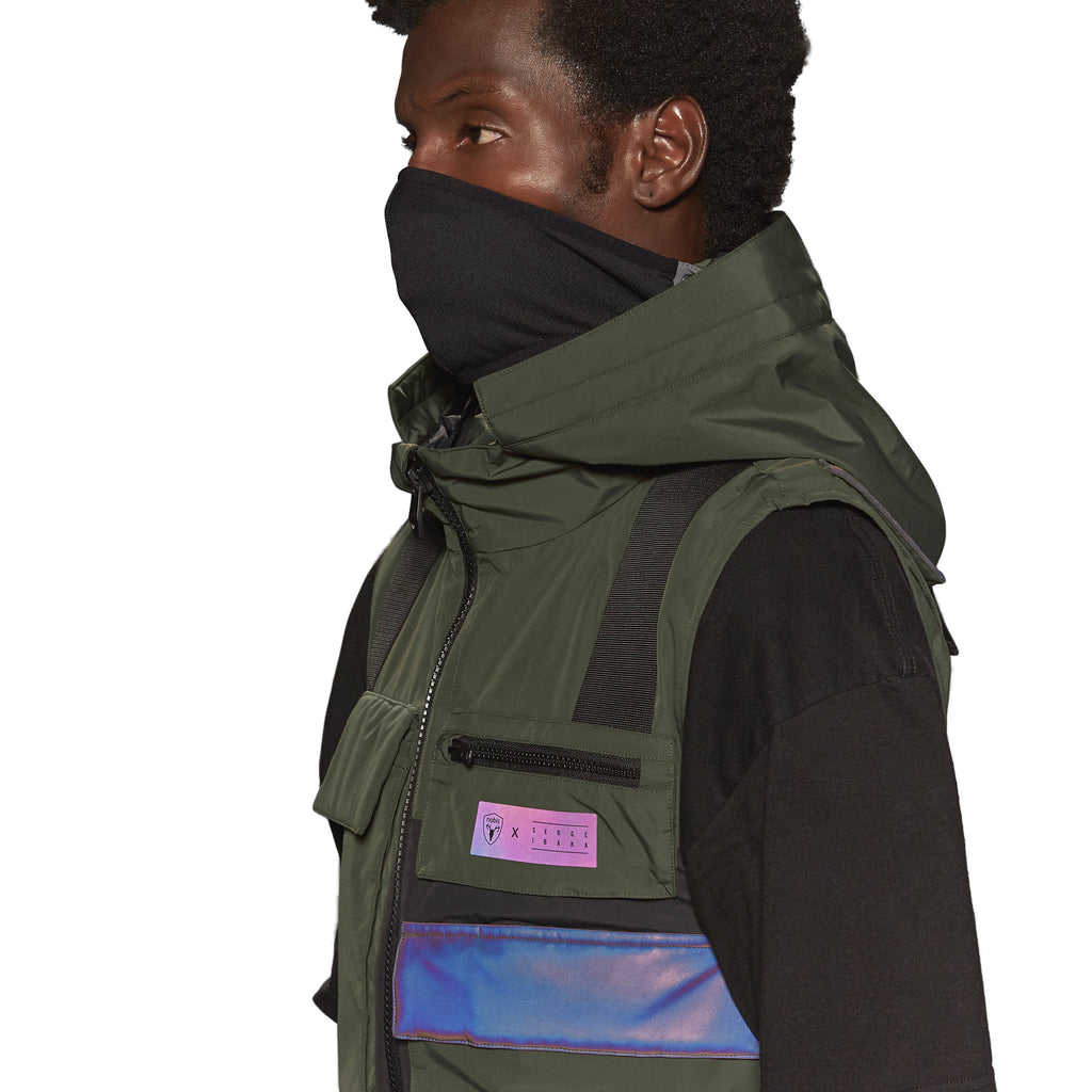 Unisex waist length hooded tactical vest with multiple exterior pockets on front and back, and adjustable side webbing fasteners, colour blocked in Fatigue/Black