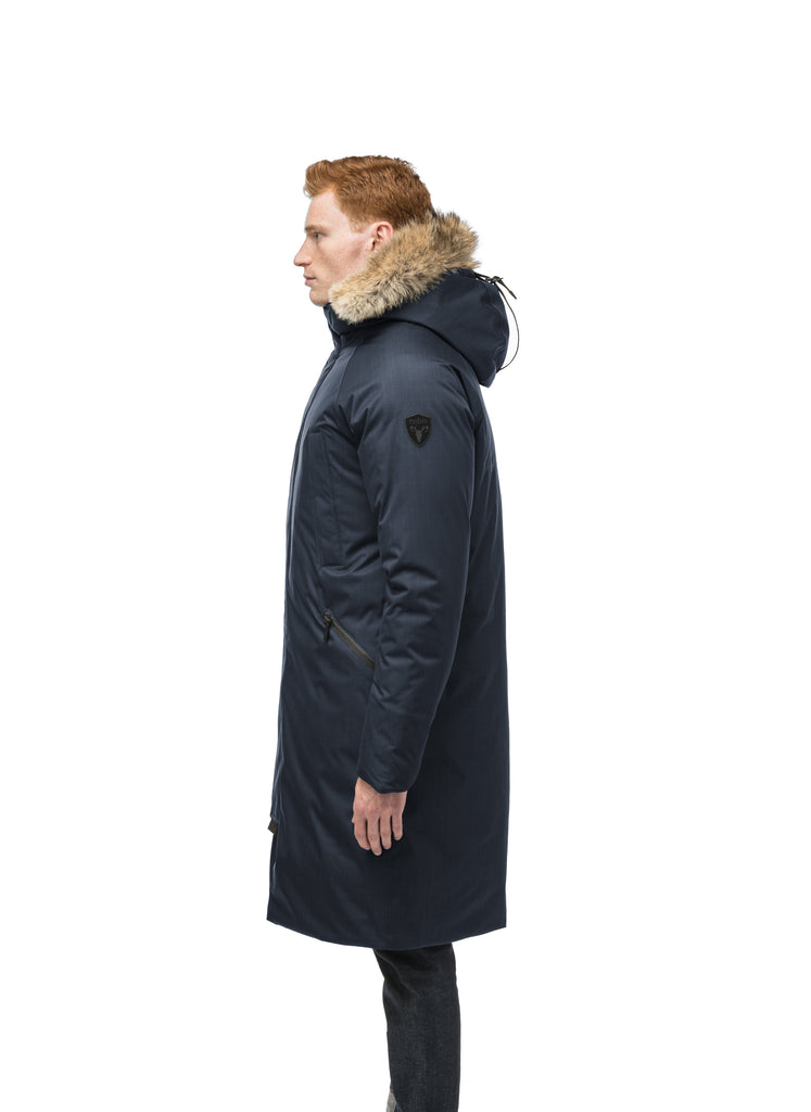 This ankle length men's down filled parka doubles as an over coat with a removable fur trim on the hood in Navy