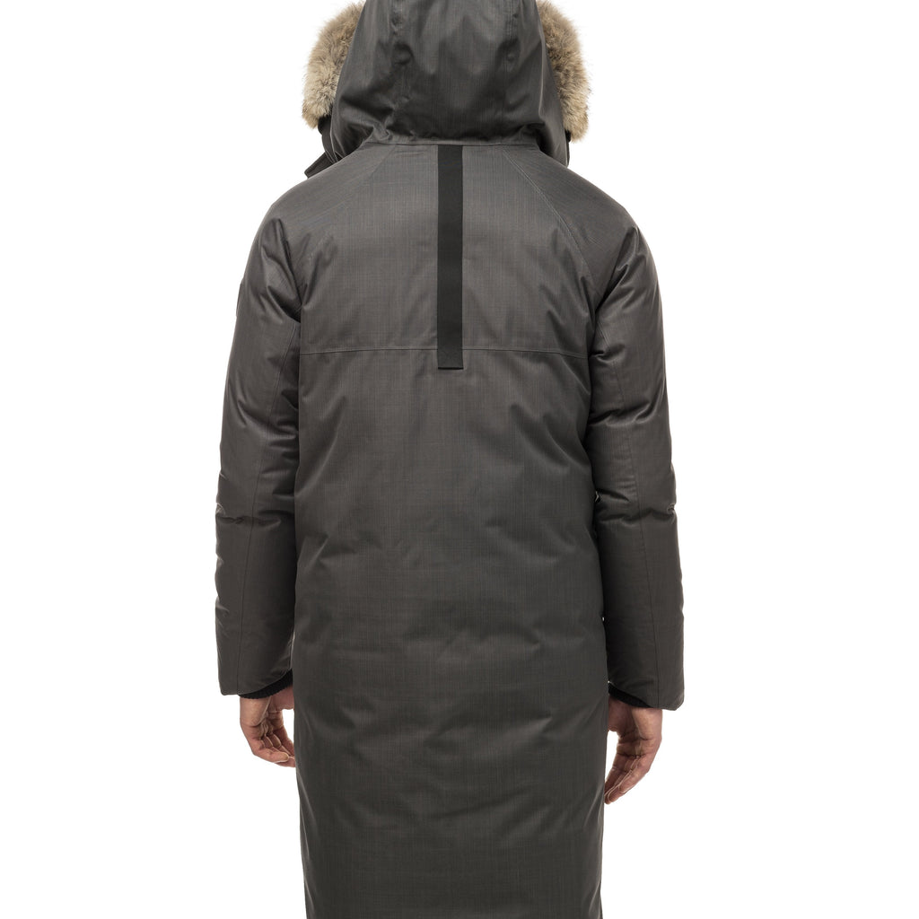 This ankle length men's down filled parka doubles as an over coat with a removable fur trim on the hood in Steel Grey