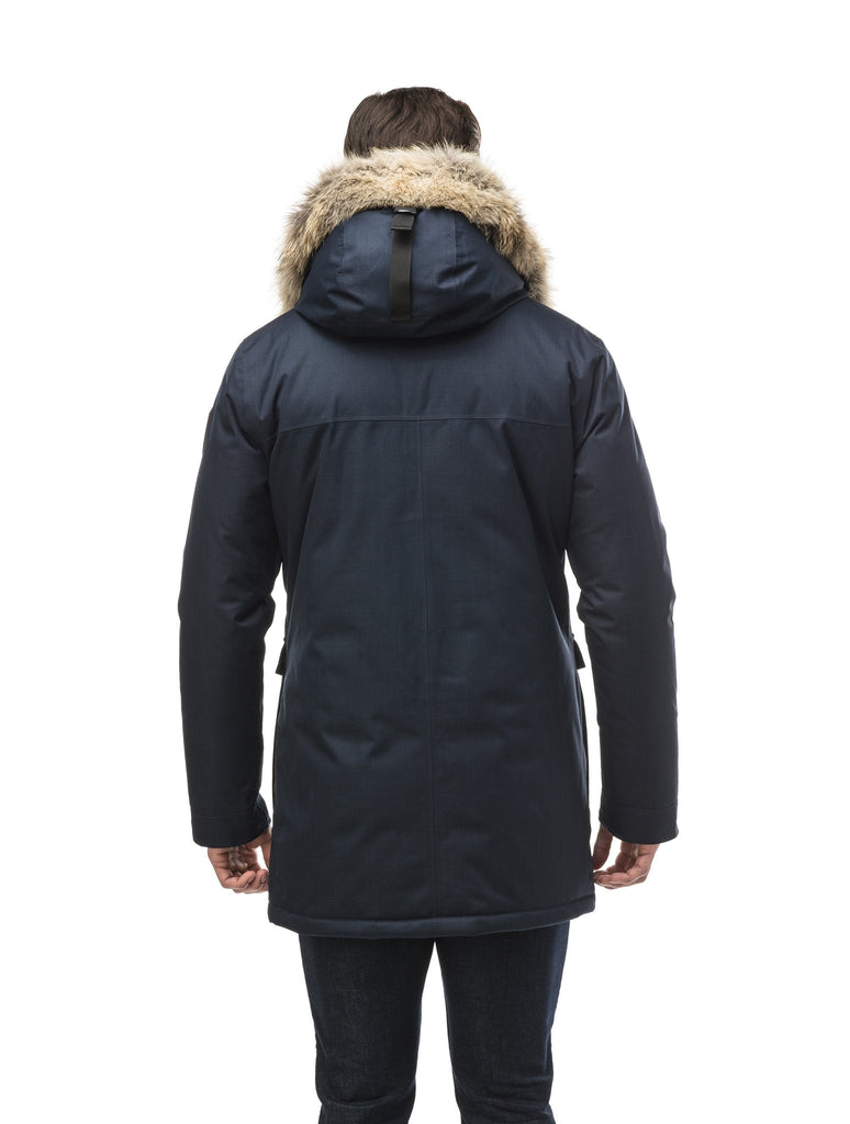 Men's slim fitting waist length parka with removable fur trim on the hood and two waist patch pockets in CH Navy