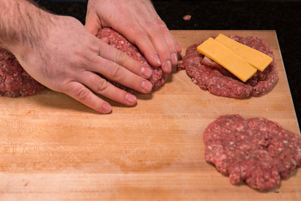 Sealing the stuffed burger patties