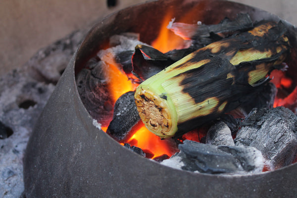 Turn your whole corn on the cob frequently on the Lump charcoal fire