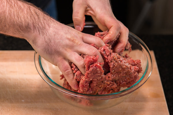 Mixing the ground beef