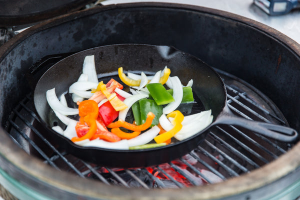 fajita vegetables over the cast iron skillet
