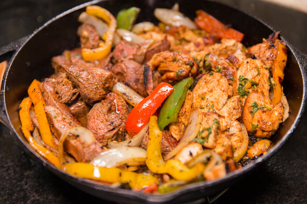 chicken and steak fajitas over Fogo Charcoal
