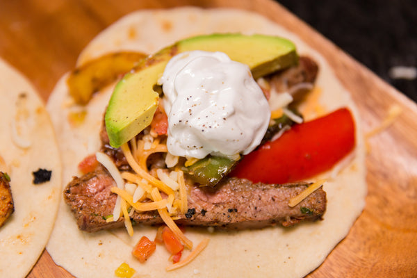 fajitas with toppings over a tortilla