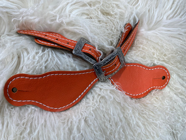 Orange on dark leather
