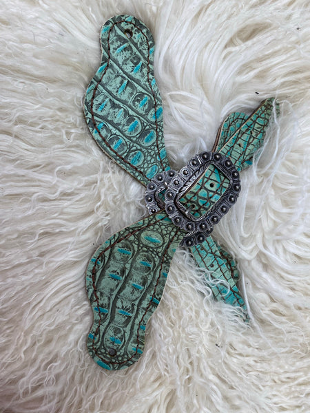 Antique turquoise gator on dark leather