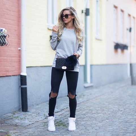 Team It Up With Ripped Denim and Sneakers
