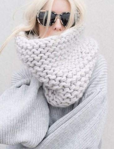 Throw A Cozy Knitted Scarf