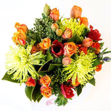 A mix of bright orange, green, red, yellow, purple flowers, delivered in a posy bag, Beautiful fresh flowers, quality goods and gifts. Free delivery within Auckland and North Shore. Birthday, anniversary, congratulations, new baby, hospital, sympathy, corporate, client gifts, love.