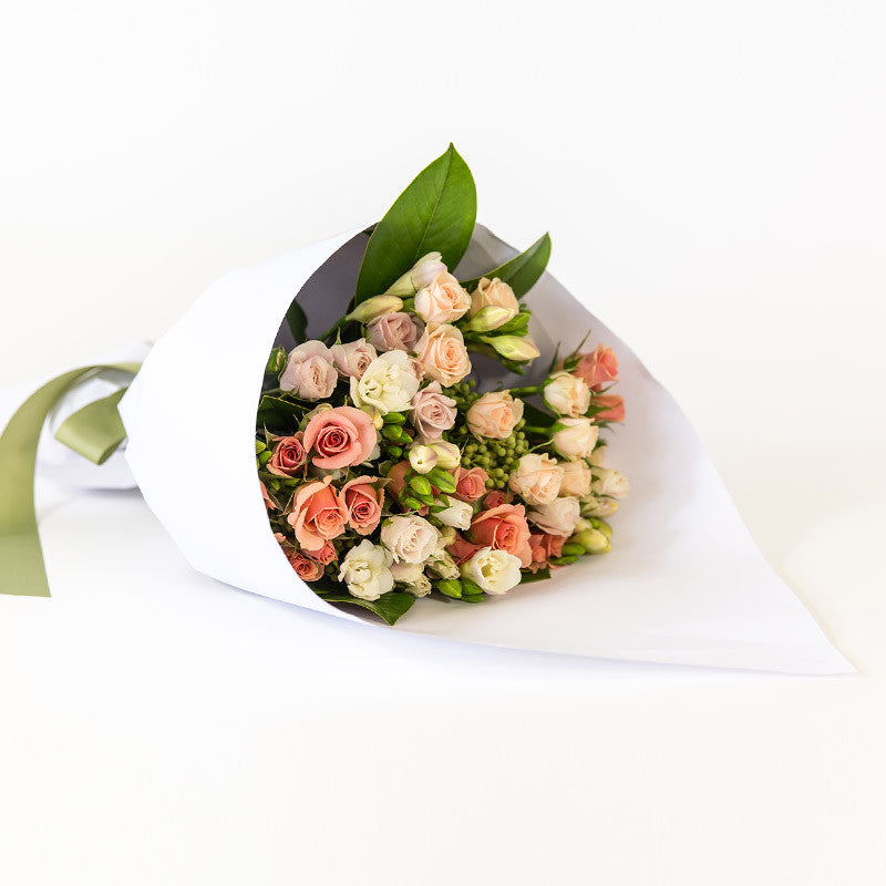 Romantic blush, apricot, pastel roses mixed with freesias, seasonal availability, wrapped beautifully, Beautiful fresh flowers, quality goods and gifts. Free delivery within Auckland and North Shore. Birthday, anniversary, congratulations, new baby, sympathy, corporate, client gifts, love.