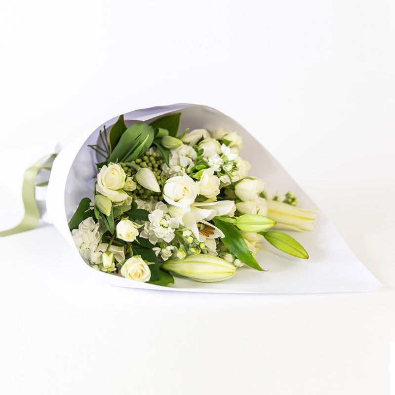 A classic bouquet of white and green fresh flowers, wrapped beautifully, Beautiful fresh flowers, quality goods and gifts. Free delivery within Auckland and North Shore. Birthday, anniversary, congratulations, new baby, sympathy, corporate, client gifts, love.