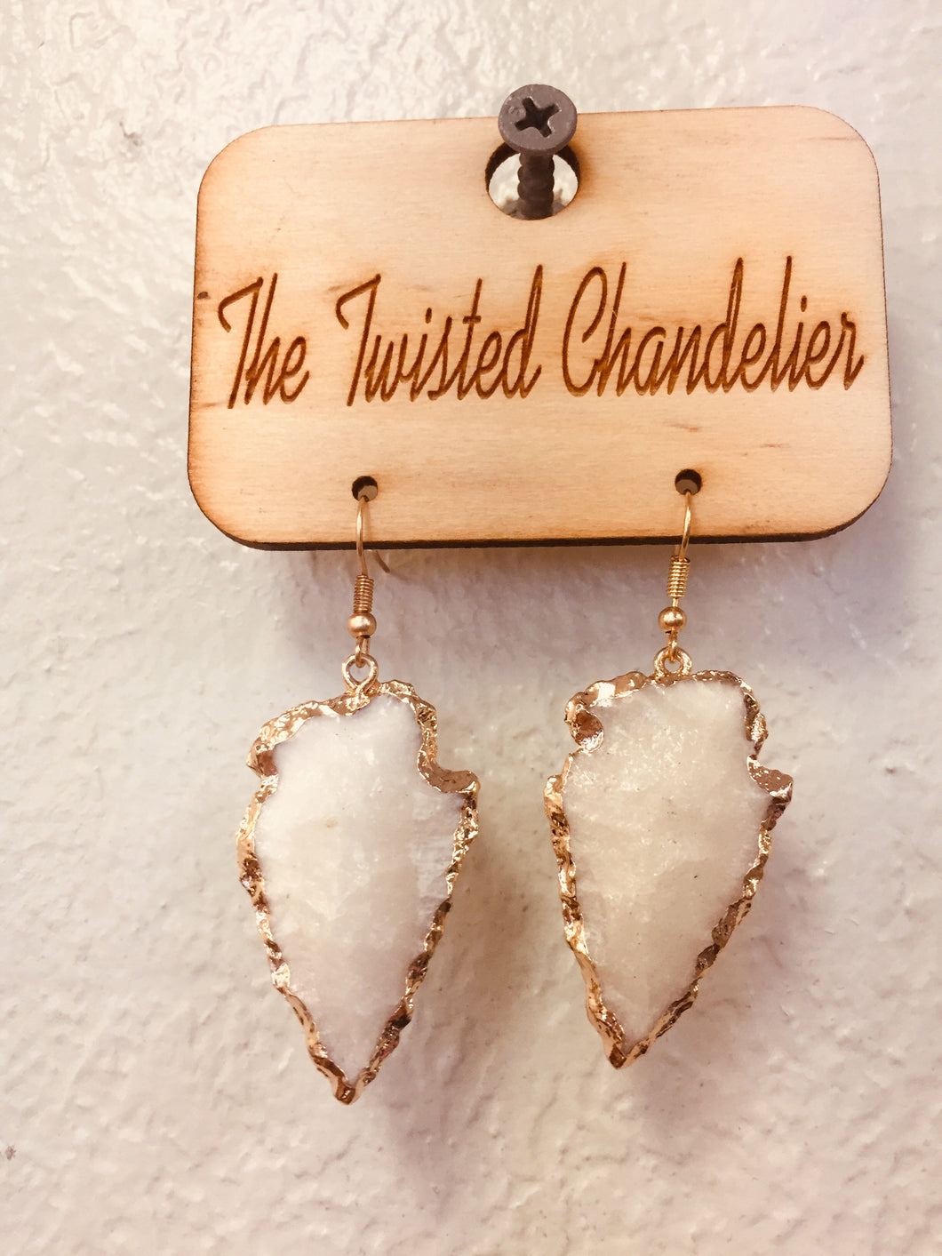 White arrowhead- e984-The Twisted Chandelier--The Twisted Chandelier