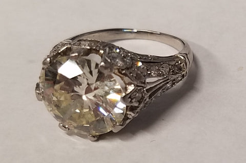 A bulky, traditional family heirloom wedding ring with a five-carat diamond, which was brought to us to be repurposed as a custom made wedding ring.