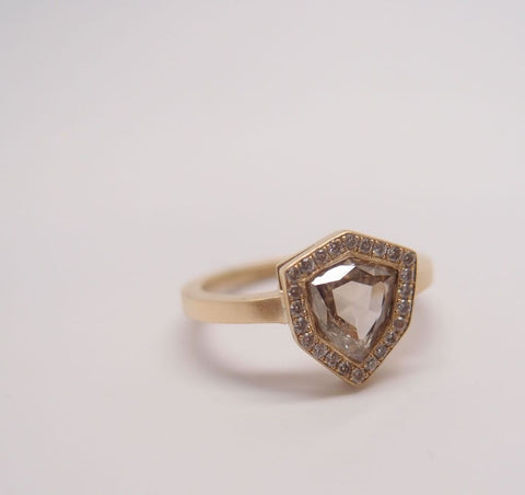 This one-of-a-kind Champagne Diamond Shield Ring from Marion Cage features a pave diamond halo, the kind of unique detail you can request when you custom make wedding rings.