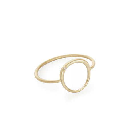 Gold jewelry, such as this Offset Circle Ring in 14k yellow gold from Marion Cage, can be cleaned simply by using warm, soapy water and a soft cloth.