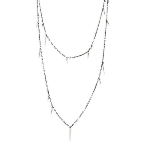 Oxidized silver jewelry, such as this Small Point Scatter Necklace in sterling silver and oxidized silver from Marion Cage, should be cleaned using warm, soapy water or a soft cloth.