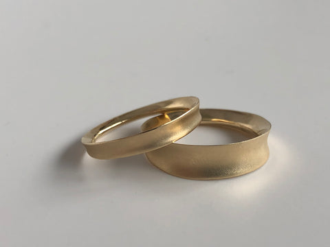 A set of matching gold wedding bands from Marion Cage.