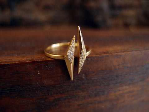 A gold ring featuring diamonds, made by Marion Cage and customizable to your liking.