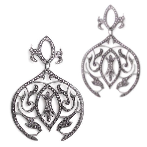 The dark gunmetal gray of black rhodium plating in these Arabesque Dangle Earrings feels cool and edgy, while the sparkle of the black pave diamonds becomes more subtle.