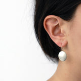 large disc drop earrings