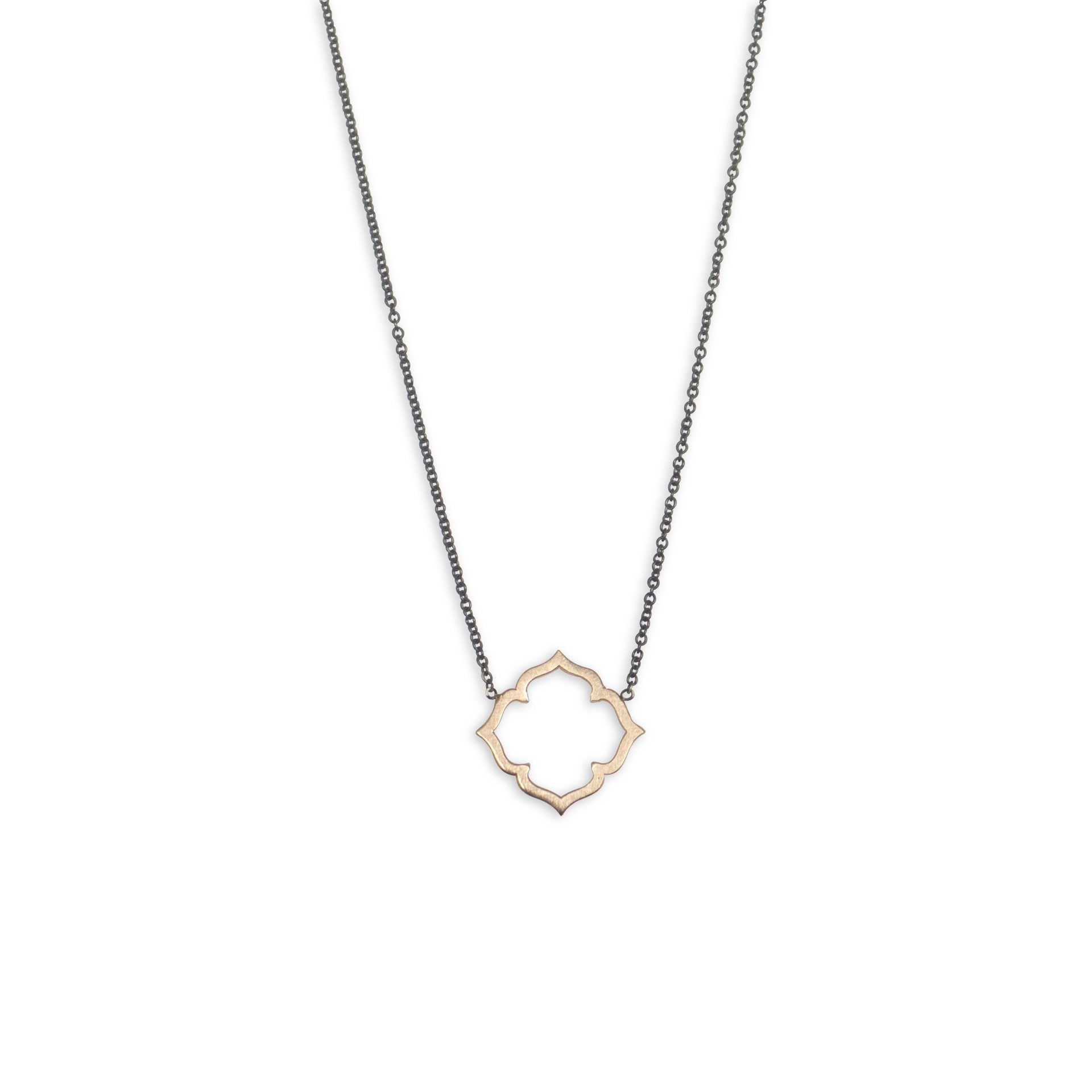 14k yellow gold on an oxidized chain clover necklace