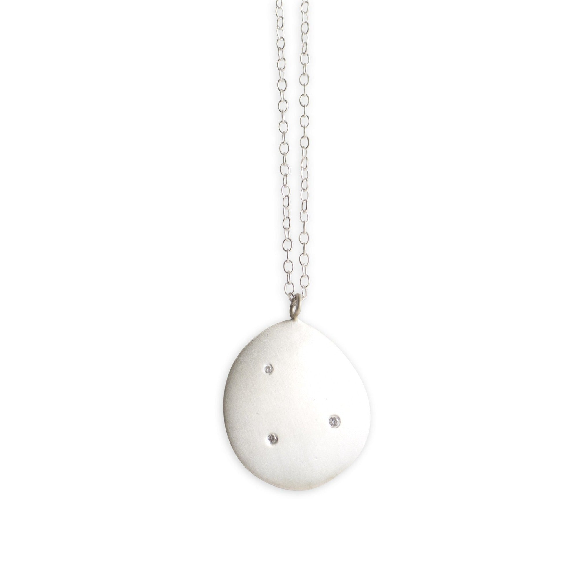 sterling silver on a sterling silver chain with white diamonds large disc pendant
