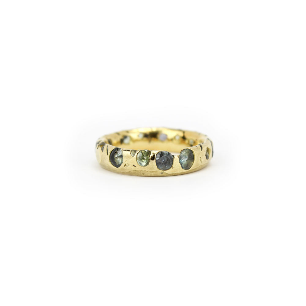 confetti ring with green sapphires